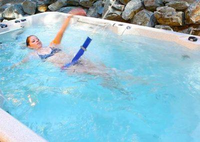 A woman swimming in the swim spa